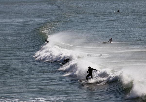 Croyde Bay Beach Surfers On Waves