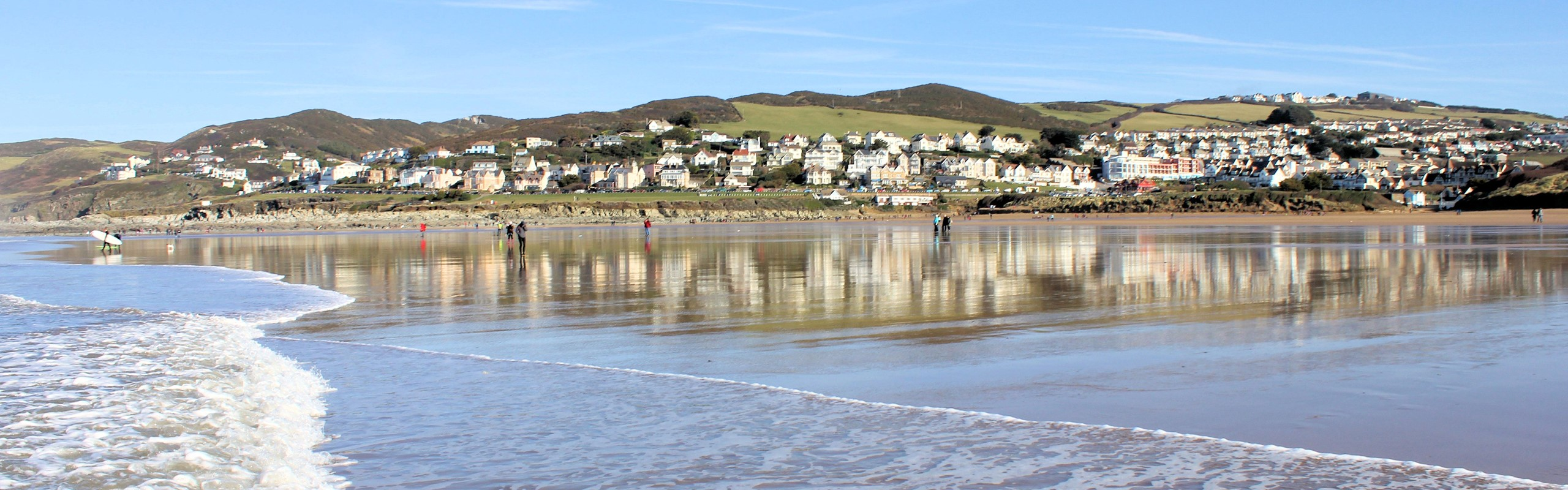 Woolacombe With Waves From Beach To Village