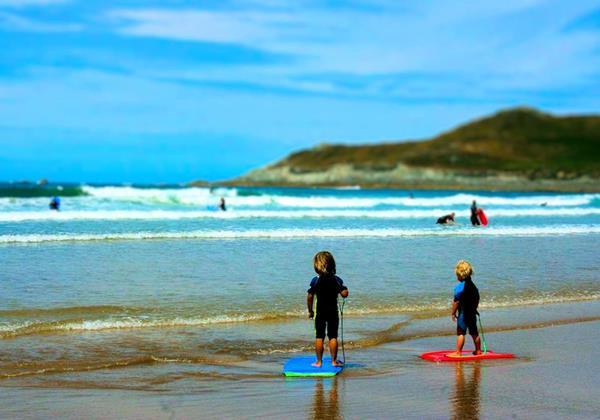 CHILDREN SURFING BARICANE HORIZ Resized And Refocused