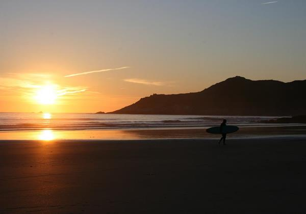 Sunset And Morte Point With Surfer Walking