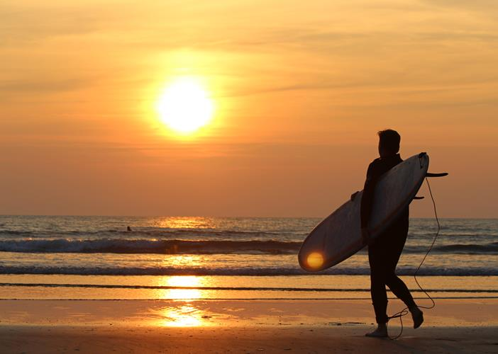 Fab Surfer Going In With Sunset
